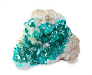 Emerald green dioptase crystals on white background